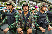 27 MAY 2014 - BANGKOK, THAILAND: Thai soldiers on duty in Victory Monument during an anti-coup protest. Several hundred people protested against the coup in Bangkok at Victory Monument. It was the fourth straight day of pro-democracy rallies in the Thai capital as the army continued to tighten its grip on Thai life. The protest Tuesday was the smallest so far.     PHOTO BY JACK KURTZ