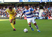 Massimo Luongo (QPR midfielder) powering away from Tyler Walker (Nottingham Forest striker) during the Sky Bet Championship match between Queens Park Rangers and Nottingham Forest at the Loftus Road Stadium, London, England on 12 September 2015. Photo by Matthew Redman.
