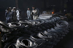 April 27, 2018 - Lahore, Pakistan - Pakistani laborers are busy melting steel and shaping rods for construction at the steel factory in Salamatpura area and the Federal Budget for Financial Year 2018-2019 has also been presented in the Parliament. Labor Day is commemorated across the world on 1st May to honor the contributions that workers make to the strength, prosperity, laws and well-being of the country. (Credit Image: © Rana Sajid Hussain/Pacific Press via ZUMA Wire)