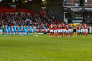 Charlton Athletic and Barnsley players observe a minutes silence in memory of the 96 that died in the Hillsbrough disaster 25 years ago before the Sky Bet Championship match at The Valley, London<br /> Picture by David Horn/Focus Images Ltd +44 7545 970036<br /> 15/04/2014