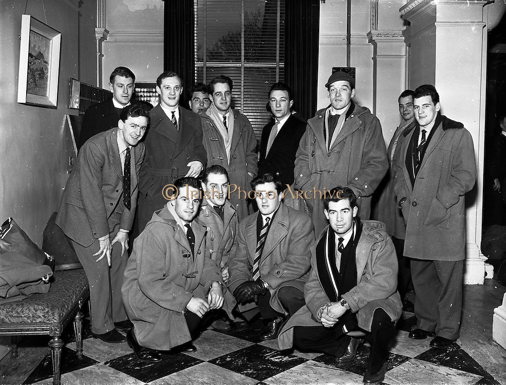 Some of the English team on arrival by boat in Dublin, ahead of the game against Ireland,..Irish Rugby Football Union, Ireland v England, Five Nations, English team arrives in North Wall, Dublin, Ireland, Friday 13th February, 1959,.13.2.1959, 2.13.1959,..English Team, ..J G G Hetherington, Wearing number 1 English jersey, Full Back, Northhampton Rugby Football Club, Northhampton, England, ..P H Thompson, Wearing number 5 English jersey, Left Wing, Waterloo Rugby Football Club, Liverpool, England,..J Butterfield, Wearing number 4 English jersey, Captain of the English team, Left Centre, Northhampton Rugby Football Club, Northhampton, England, ..M S Phillips, Wearing number 3 English jersey, Right centre, Oxford University Rugby Football Club, Oxford, England,..P B Jackson, Wearing number 2 English jersey, Right Wing, Coventry Rugby Football Club, Coventry, England, ..A B W Risman, Wearing number 6 English jersey, Outside Half, Manchester University Rugby Football Club, Manchester, England,..S R Smith, Wearing number 7 English jersey, Scrum Half, Cambridge University Rugby Football Club, Cambridge, England,..L H Webb, Wearing number 8 English jersey, Forward, Bedford Rugby Football Club, Bedford, England,..J A S Wackett, Wearing number 9 English jersey, Forward, Rosslyn Park Rugby Football Club, London, England,..G J Bendon, Wearing number 10 English jersey, Forward, Wasps Rugby Football Club, London, England,..R W D Marques, Wearing number 11 English jersey, Forward, Harlequins Rugby Football Club, London, England,..J D Currie, Wearing number 12 English jersey, Forward, Harlequins Rugby Football Club, London, England,..A J Herbert, Wearing number 13 English jersey, Forward, Wasps Rugby Football Club, London, England,..A Ashcroft, Wearing number 14 English jersey, Forward, Waterloo Rugby Football Club, Liverpool, England,..J W Clements, Wearing number 15 English jersey, Forward, Old Cranleighans Rugby Football Club, Surrey, England, .