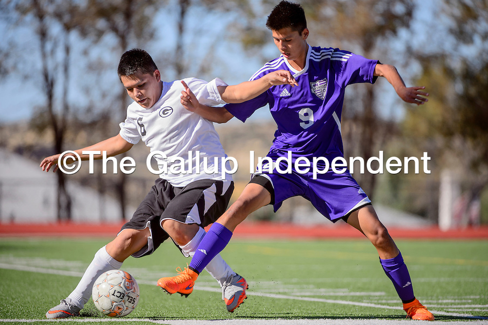 Gallup Bengal Juan Escoto (6) and Miyamura Patriot Matthew Ruiz (9) compete for control of the ball Thursday at Public School Stadium in Gallup.