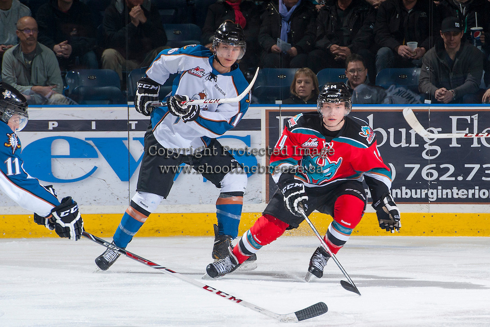 KELOWNA, CANADA - DECEMBER 7: Rourke Chartier #14 of the Kelowna Rockets is checked by Hudson Elynuik #16 of the Kootenay Ice on December 7, 2013 at Prospera Place in Kelowna, British Columbia, Canada.   (Photo by Marissa Baecker/Shoot the Breeze)  ***  Local Caption  ***