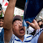 """TOKYO, JAPAN - JULY 1: Anti-Abe protesters gathers and chant """"Abe wa Yamero!"""" """"Resign Prime Minister Abe!"""" during the speech of Japanese Prime Minister Shinzo Abe for his candidate Aya Nakamura of main opposition, Liberal Democratic Party (LDP) in Akihabara, Tokyo, Japan on July 1, 2017. Tokyo Metropolitan Assembly election will be held on July 2. (Photo: Richard Atrero de Guzman/NUR Photo)"""
