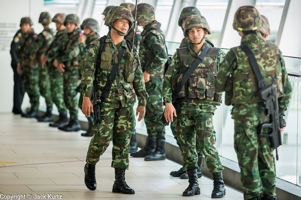 25 MAY 2014 - BANGKOK, THAILAND: Soldiers on duty in the Bangkok BTS Skytrain system. Public opposition to the military coup in Thailand grew Sunday with thousands of protestors gathering at locations throughout Bangkok to call for a return of civilian rule and end to the military junta.     PHOTO BY JACK KURTZ