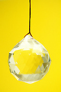 Still life of a prism reflecting a yellow background