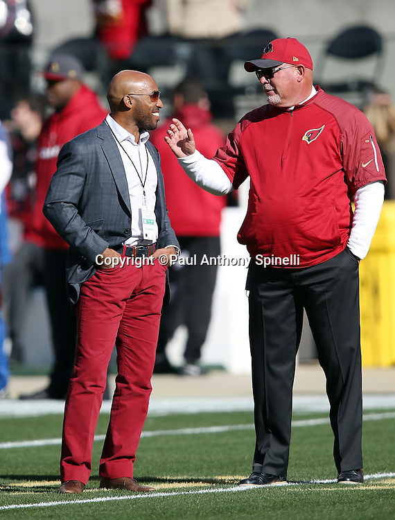 (L-R) Television sports analyst Ronde Barber smiles as he talks to Arizona Cardinals head coach Bruce Arians before the 2015 week 12 regular season NFL football game against the San Francisco 49ers on Sunday, Nov. 29, 2015 in Santa Clara, Calif. The Cardinals won the game 19-13. (©Paul Anthony Spinelli)
