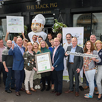 "REPRO FREE<br /> The Kinsale Giant with members of Kinsale Chamber of Tourism & Business, Kinsale Good Food, Kinsale Food Tours and local producers as they welcomed Foodie Destinations judges Zack Gallagher and Wendy Kavanagh. Kinsale is one of the Restaurant Association of Ireland's Top 10 Foodie Destinations 2017. <br /> Picture. John Allen<br /> <br />      			<br /> PRESS RELEASE<br /> For Immediate Release: Saturday 19th August 2017<br /> KINSALE PUTS ITS BEST FORK FORWARD IN FOODIE DESTINATIONS 2017' <br /> Kinsale welcomed Foodie Destinations judges Zack Gallagher and Wendy Kavanagh, as it showcased Kinsale as one of the Restaurant Association of Ireland's Top 10 Foodie Destinations 2017. <br /> During the judging process, Kinsale Chamber of Tourism & Business, Kinsale Good Food Circle and Kinsale Food Tours organised a mini food tour of some of Kinsale's restaurants and shops, sampling local produce, meeting producers and a number of people involved with food tourism and education. <br /> ""We are delighted to be shortlisted this year and wish to thank the judges for visiting Kinsale today as well as everyone for voting for Kinsale in the public vote over the past few weeks.<br /> ""Kinsale has so many businesses involved in the food and drink industry, with over 60 restaurants and cafes, supplied by many producers and employing over 1,000 people in the town,"" said Ciarán Fitzgerald, Chairman Kinsale Chamber of Tourism & Business.  <br /> As well as having a full calendar of foodie events and being the starting point of the Wild Atlantic Way, Kinsale is continually evolving as the town welcomes new people, their business ideas and inspiration. <br /> ""We believe that our people, produce and passion are the recipe for success. The local provenance of our meat, fish, seafood, fruit and vegetables together with the mix talent of people from the locality and all over the world combine to offer great food, service and value to all,"" added Ciarán Fitzgerald.<br /> The 'Foodie Destination of Ireland' award recognises a desti"