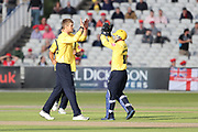 Tim Ambrose of the Birmingham Bears celebrates with Alex Thomson of the Birmingham Bears team mates a fall of a wicket during the Vitality T20 Blast North Group match between Lancashire Lightning and Birmingham Bears at the Emirates, Old Trafford, Manchester, United Kingdom on 10 August 2018.