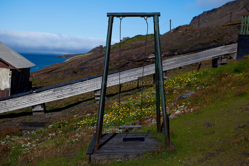 A child's swing, outside the house where Russian ballet dancer Maya Plisetskaya lived as a child, .seen from the many steps on the staircase from the port to the town Barentsburg, a Russian Coal mining town in the Norwegian Archipelego of Svalbard. Once home to around 2000 miners and their families, less than 500 people now live here.
