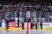 REGINA, SK - MAY 19: Ice officials stand on guard for the national anthem at the start of the game between Acadie-Bathurst Titan and Swift Current Broncos at the Brandt Centre on May 19, 2018 in Regina, Canada. (Photo by Marissa Baecker/CHL Images)