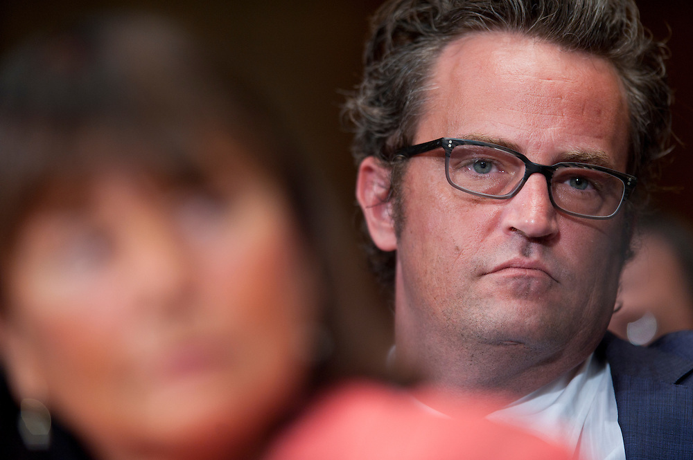 """Actor MATTHEW PERRY looks on as JEANNE LAFAZIA, chief judge of the Rhode Island District Court testifies before a Senate Judiciary Committee hearing """"Drug and Veterans Treatment Courts: Seeking Cost-Effective Solutions for Protecting Public Safety and Reducing Recidivism."""""""