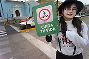 Mime as crossing guard to get people to only go with the light, Lima, Peru