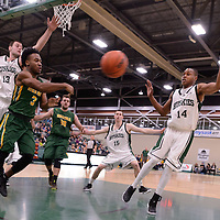 1st year guard Johneil Johnson (3) of the Regina Cougars in action during the home game on December  3 at Centre for Kinesiology, Health and Sport. Credit: Matt Johnson/Arthur Images