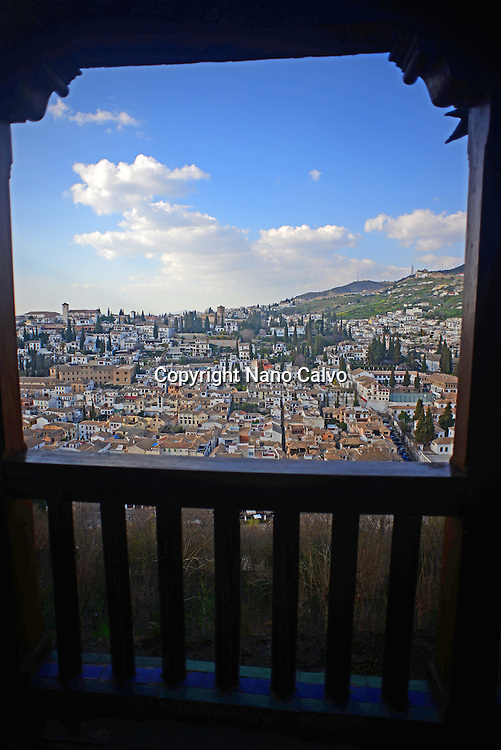 View of Granada from Nasrid Palaces at The Alhambra, palace and fortress complex located in Granada, Andalusia, Spain