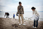 Tokyo -  May 29, 2010 - Konkatsu, the Japanese marriage Hunting. On Miura beach, 80 km from Tokyo, a konkatsu tour is organized for the participants who want to collect garbage on the beach. Yasunori, 27 (center) starting to chat with a woman.