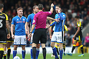Callum Camps, Steven Davies and Joe Bunney protest at referee Mr Coote's decision during the EFL Sky Bet League 1 match between Rochdale and Rotherham United at Spotland, Rochdale, England on 7 October 2017. Photo by Daniel Youngs.