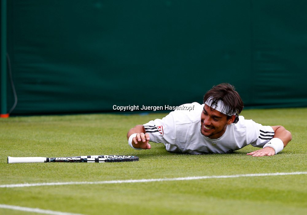 Wimbledon Championships 2013, AELTC,London,<br /> ITF Grand Slam Tennis Tournament, Fabio Fognini (ITA) ist ausgerutscht<br /> und liegt grinsend auf dem Boden,Einzelbild,Ganzkoerper,Querformat,<br /> witzig,lustig,Emotion,
