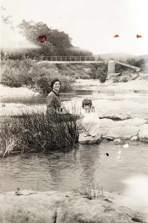 happy smiling mother posing with daughter in nature setting France ca 1930s