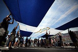 June 15, 2018 - Athens, Attica, Greece - Demonstration burn flag as they protest against the agreement between Greece and FYROM, outside the Greek Parliament. The agreement seems to resolve a 27-year problem over the name of the former Yugoslav republic and the use of the term 'Macedonia' which would result in FYROM being renamed to North Macedonia. (Credit Image: © Giorgos Georgiou/NurPhoto via ZUMA Press)