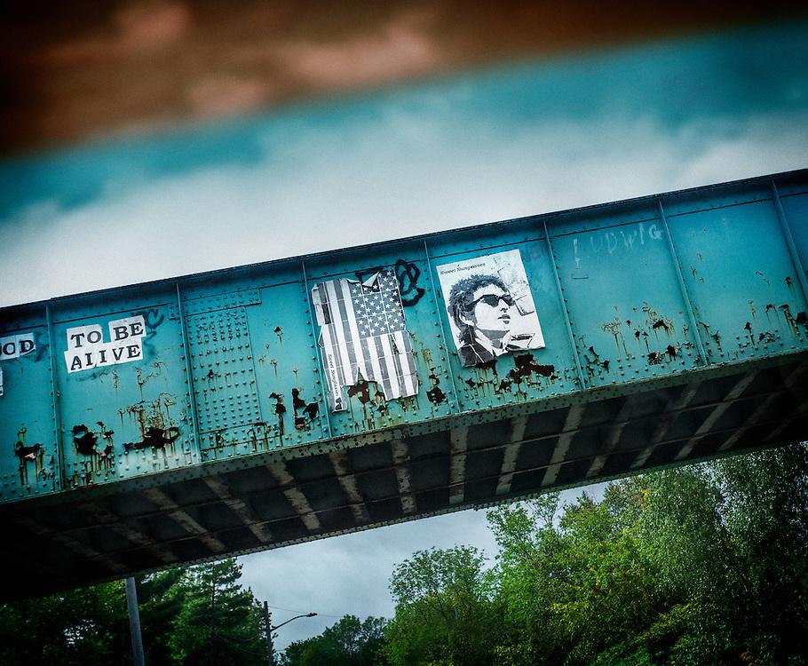 Bridge with a Bob Dylan poster.