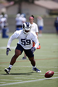 Los Angeles Rams rookie linebacker Micah Kiser (59), a 5th round pick in the 2018 NFL draft, chases a loose ball during the Los Angeles Rams NFL football camp on Monday, June 4, 2018 in Thousand Oaks, Calif. (©Paul Anthony Spinelli)