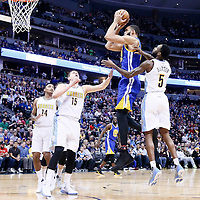 13 February 2017: Golden State Warriors center JaVale McGee (1) takes a jump shot over Denver Nuggets forward Nikola Jokic (15) and past Denver Nuggets guard Will Barton (5) during the Denver Nuggets 132-110 victory over the Golden State Warriors, at the Pepsi Center, Denver, Colorado, USA.