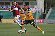 Robbie Willmott of Newport (right) takes on Ben Tozer of Northampton. Skybet football league two match, Newport county v Northampton Town at Rodney Parade in Newport, South Wales on Saturday13th Sept 2014<br /> pic by Mark Hawkins, Andrew Orchard sports photography.