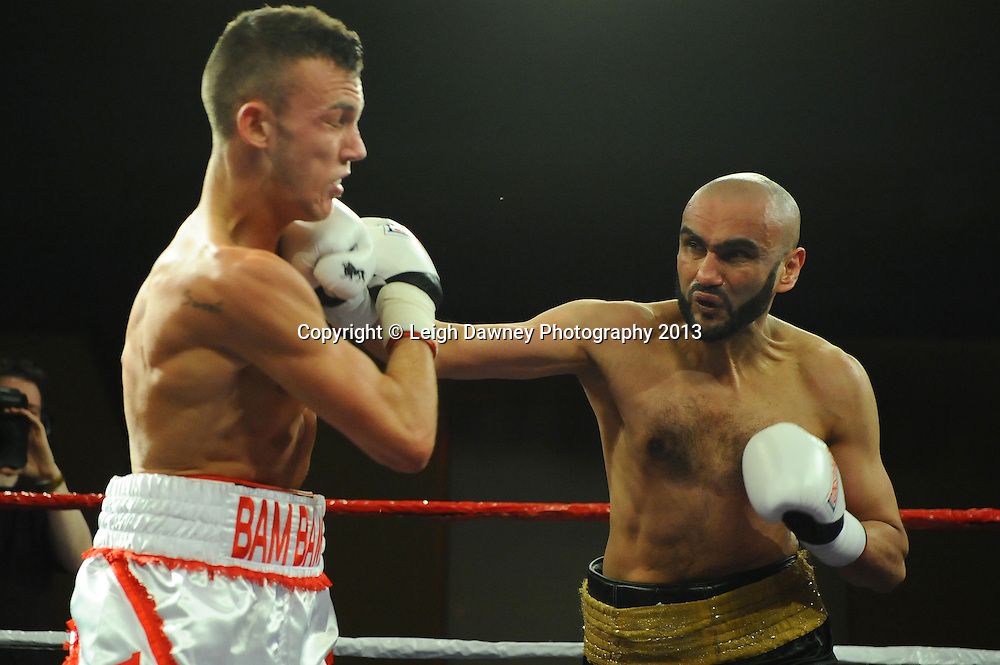 Ben Jackson (white/red shorts) defeats Sid Razak in Light Welterweight contest at Rainton Meadows Arena, Houghton Le Spring, Tyne & Wear, UK. 15th February 2013. Frank Maloney Promotions. © Leigh Dawney 2013