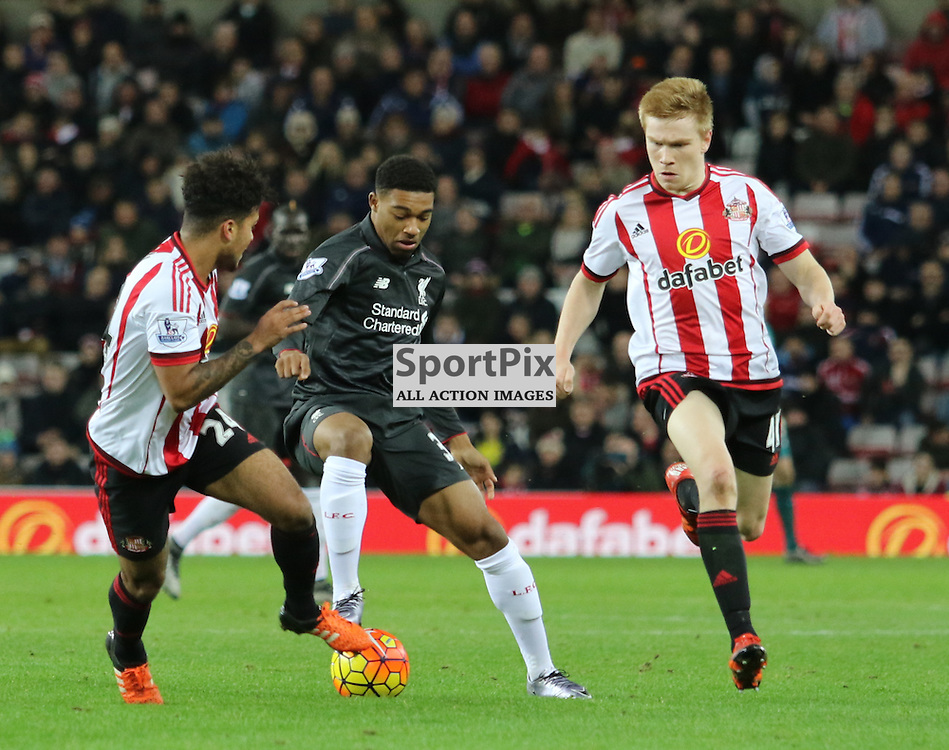 Jordan Ibe holds  off some sunderland defenders during the Sunderland FC v Liverpool FC English Premier League 30th March 2015...©Edward Linton | SportPix.org.uk