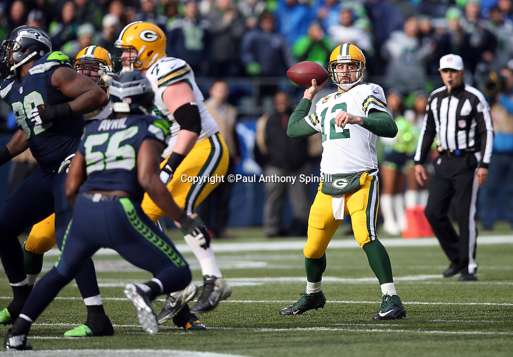 Green Bay Packers quarterback Aaron Rodgers (12) throws a first down pass to the Seattle Seahawks 41 yard line during the NFL week 20 NFC Championship football game against the Seattle Seahawks on Sunday, Jan. 18, 2015 in Seattle. The Seahawks won the game 28-22 in overtime. ©Paul Anthony Spinelli