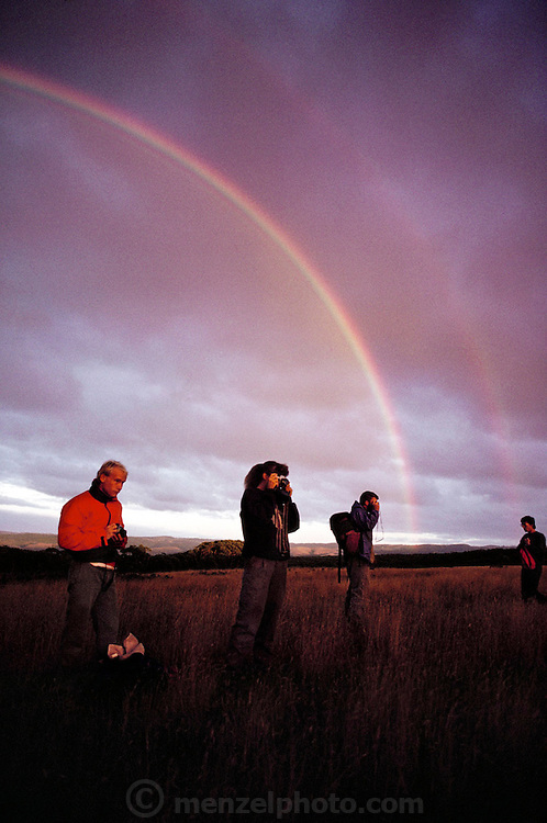 Double rainbows at dawn as students from Oregon State University arrive at camp at Dinosaur Cove, Cape Otway, southern Australia. Dinosaur Cove is the world's first mine developed specifically for paleontology, normally the scientists rely on commercial mining to make the excavations. The site is of particular interest as the fossils found date from about 100 million years ago, when Australia was much closer to the South Pole than today.  [1989]