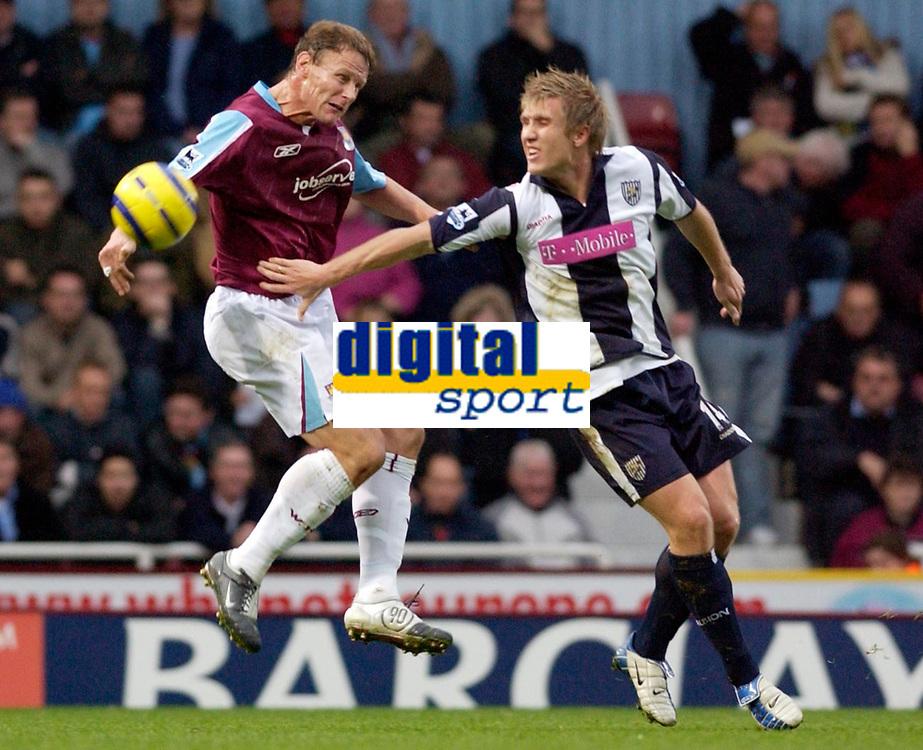 Photo: Daniel Hambury.<br />West Ham Utd v West Bromwich Albion. The Barclays Premiership. 05/11/2005.<br />West Ham's Teddy Sheringham (L) and West Brom's Martin Albrechtsen battle for the ball.