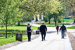 © Licensed to London News Pictures. 14/04/2020. London, UK. Police patrol a quiet Green Park in London as the majority of people continue to stay away from the Capital during lockdown as one in five deaths are now linked to Covid-19 and Foreign Secretary, Dominic Raab announced yesterday that lockdown could last another month. Photo credit: Alex Lentati/LNP