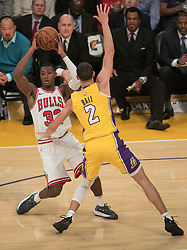 November 21, 2017 - Los Angeles, California, United States of America - Kris Dunn #32 of the Chicago Bulls  tries to pass the ball past Lonzo Ball #2 of the Los Angeles Lakers during their game on Tuesday November 21, 2017 at the Staples Center in Los Angeles, California. Lakers defeat Bulls, 103-94. JAVIER ROJAS/PI (Credit Image: © Prensa Internacional via ZUMA Wire)