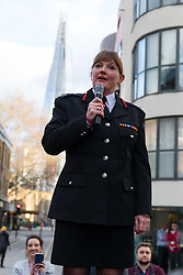 © Licensed to London News Pictures. 23/12/2019. London, UK. London Fire Commissioner (LFC), Dany Cotton makes a speech from a vintage fire engine after being greeted by members and family of the Fire Brigade on her final day in office. Hundreds of firefighters lined Union Street in London today to provide a Guard of Honour on the final day in office for London Fire Commissioner, Danny Cotton. Photo credit: Vickie Flores/LNP