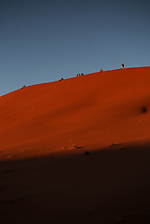 NAMIBIA SOSSUSVLEI 22APR14 - Sun worshippers climb the Big Daddy dune during sunrise in the Deadvlei in the Sossusvlei in the Namib Desert, Namibia.<br /> <br /> Sossusvlei is a salt and clay pan surrounded by high red dunes, located in the southern part of the Namib Desert, in the Namib-Naukluft National Park, which is one of the major visitor attractions of Namibia.<br /> <br /> jre/Photo by Jiri Rezac<br /> <br /> © Jiri Rezac 2014