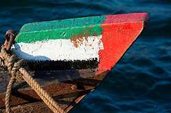 Prow of Abra water taxi painted  with flag of United Arab Emirates Dubai in United Arab Emirates