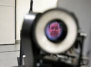 Professor Masatoshi Ishikawa poses with one of high speed vision cameras developed at Ishikawa-Oku lab at the University of Tokyo, Tokyo, Japan. Photographer: Robert Gilhooly
