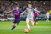 Liverpool defender Andy Robertson (26) tussles with Barcelona defender Sergi Roberto (20) during the Champions League semi-final leg 1 of 2 match between Barcelona and Liverpool at Camp Nou, Barcelona, Spain on 1 May 2019.