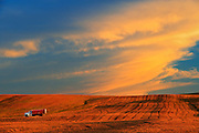Farm truck and clouds at sunset<br /> Braddock<br /> Saskatchewan<br /> Canada