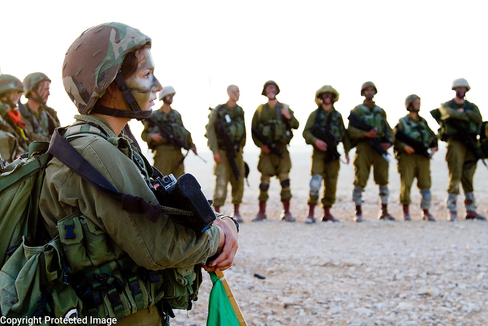 Israeli women from the Karakal unit at a morning briefing. Israeli women serve alongside men in this army unit. Photography by Debbie Zimelman, Modiin Israel. Documentary photography