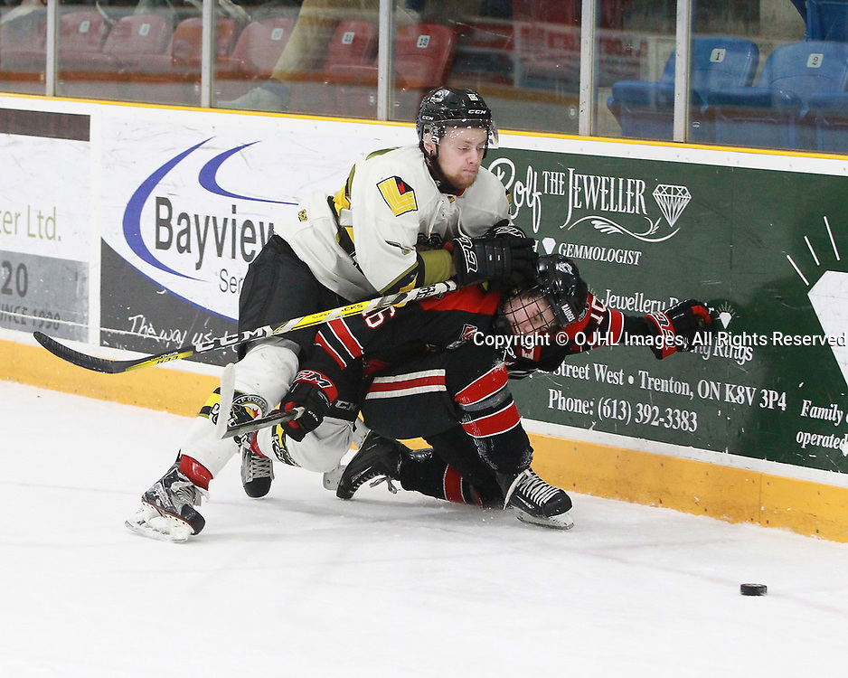 TRENTON, ON  - MAY 5,  2017: Canadian Junior Hockey League, Central Canadian Jr. &quot;A&quot; Championship. The Dudley Hewitt Cup. Game 7 between Georgetown Raiders and the Powassan Voodoos.  Justin Schebel #2 of the Powassan Voodoos makes the hit on Jack Hughes #16 of the Georgetown Raiders during the first period.<br /> (Photo by Tim Bates / OJHL Images)