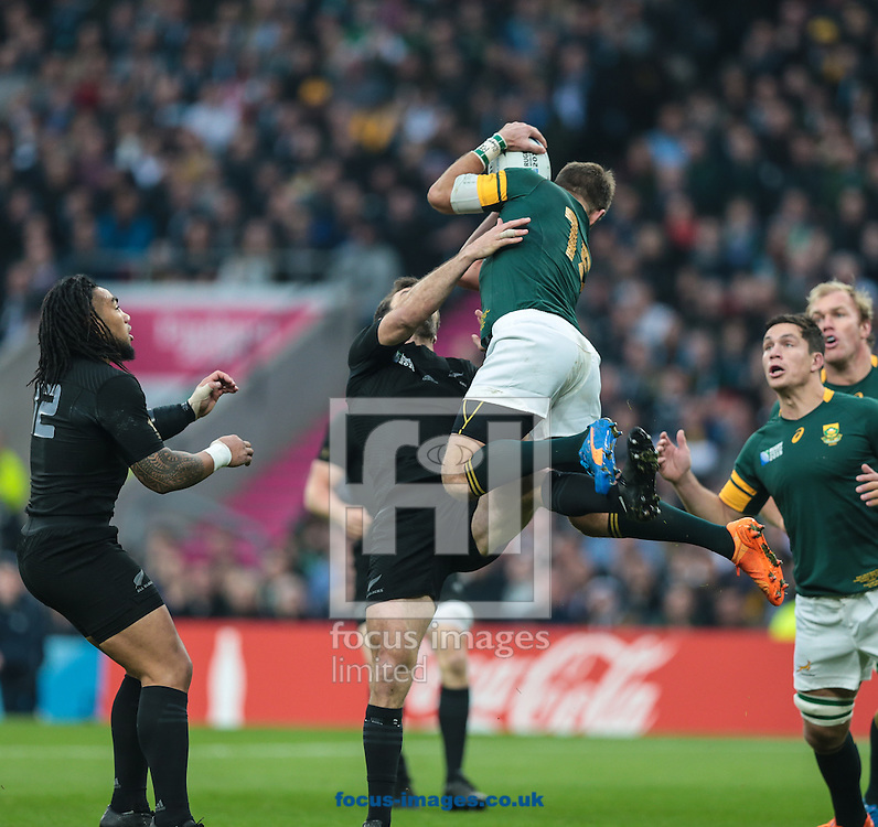 Conrad Smith of New Zealand is beaten to the ball by Willie le Roux of South Africa during the 2015 Rugby World Cup semi final match at Twickenham Stadium, Twickenham<br /> Picture by Michael Whitefoot/Focus Images Ltd 07969 898192<br /> 24/10/2015