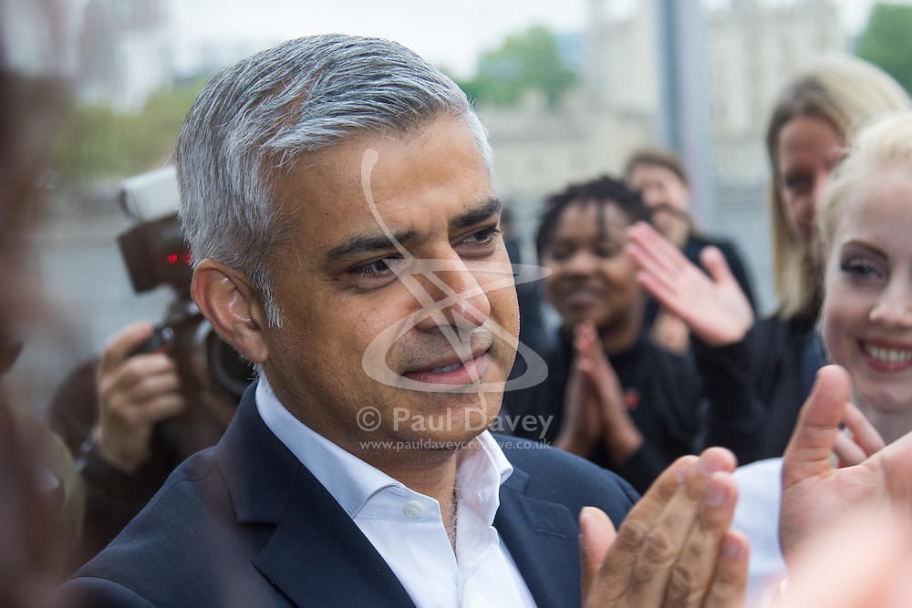 City Hall, London, May 19th 2016. PICTURED: Mayor of London Sadiq Khan applauds the dancers.<br /> <br /> The Mayor of London Sadiq Khan joins internationally-celebrated choreographer Akram Khan and Londoners from across the capital as they do their warm-ups at City Hall for the international Big Dance Pledge.<br />  <br /> The preview of the performance ahead of the world-wide Big Dance event. On Friday 20 May, over 40,000 people in 43 countries around the world will take part in the dance, which has been specially choreographed by Akram Khan.