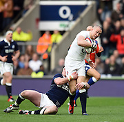 Twickenham, Great Britain, Mike BROWN, tackled during the Six Nations Rugby England vs Scotland, played at the RFU Stadium, Twickenham, ENGLAND. Saturday 14/03/2015<br /> <br /> [Mandatory Credit; Peter Spurrier/Intersport-images]
