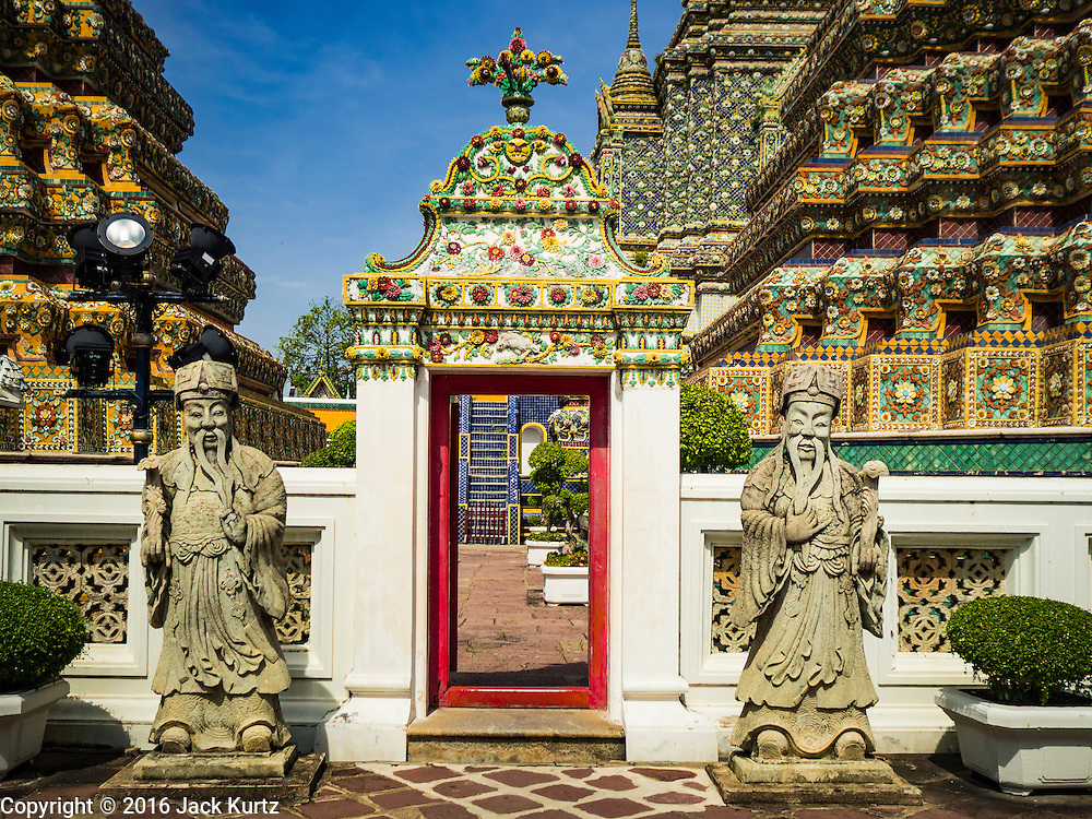 11 AUGUST 2016 - BANGKOK, THAILAND:  A gate to one of the interior courtyards at Wat Pho in Bangkok. Wat Pho (the Temple of the Reclining Buddha), is formally known as Wat Phra Chetuphon. It's one of the largest temple complexes in Bangkok and best known for the giant reclining Buddha that measures 46 metres long and is covered in gold leaf. There is also a large ordination hall and the best known massage school in Thailand on the temple grounds.       PHOTO BY JACK KURTZ