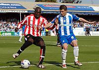 Photo: Ashley Pickering.<br /> Colchester United v Sunderland. Coca Cola Championship. 21/04/2007.<br /> Jamie Cureton of Colchester (R) battles it out with Nyron Nosworthy of Sunderland
