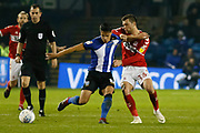 Middlesbrough midfielder Jonathan Howson (16) and Sheffield Wednesday midfielder Joey Pelupessy (8)  during the EFL Sky Bet Championship match between Sheffield Wednesday and Middlesbrough at Hillsborough, Sheffield, England on 19 October 2018.