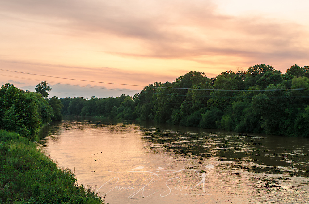 The sun sets over the Yazoo River in Greenwood, Miss. (Photo by Carmen K. Sisson)